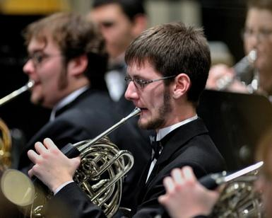 Student playing the horn.