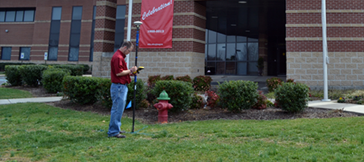 PDC's current GIS-GPS Intern, Preston Dallas, collecting data at WKU Glasgow Campus.