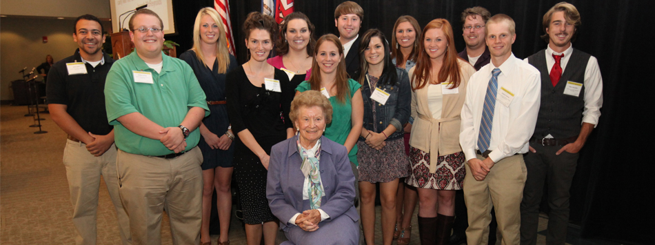 Rosella Isbell poses with recipients of three Isbell Scholarships