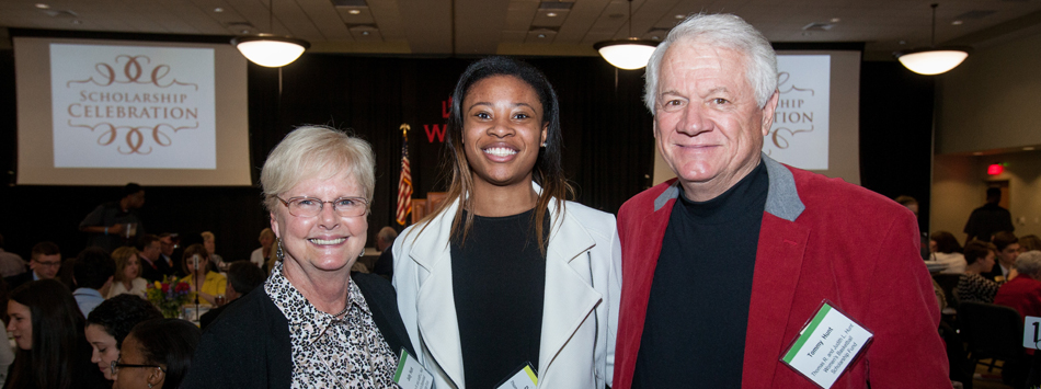 Judy and Tommy Hunt meet Dee Givens, recipient of the Thomas R. and Judith L. Hunt Women's Basketball Scholarship.