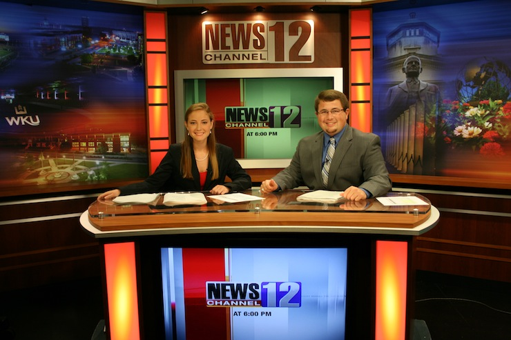 Photo of two anchors on the new set.