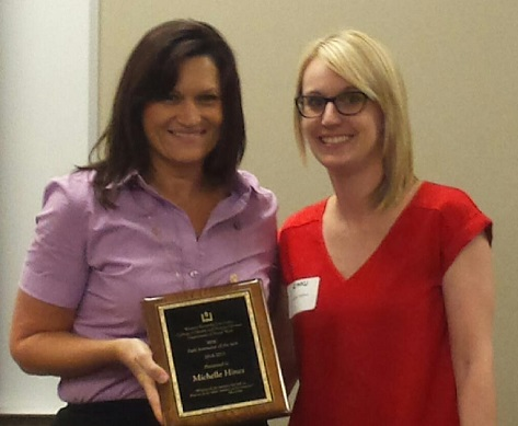 Ashley Jeffers presents Michelle Hines with 2015 BSW Field Instructor of the year award