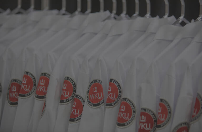 WKU Physical Therapy program jackets hung up in a row