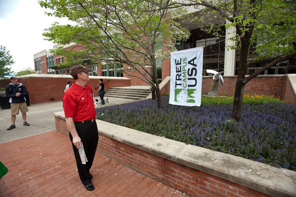 President Gary Ransdell with Tree Campus USA Flag