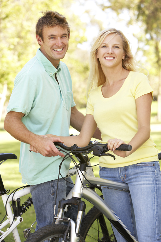 2 people on bicycles