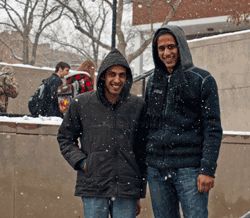 Two smiling students on campus