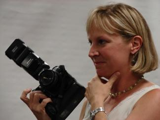 A picture of Jeanie Adams Smith holding camera