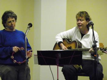 A picture of Susan Morris and Molly Kerby singing